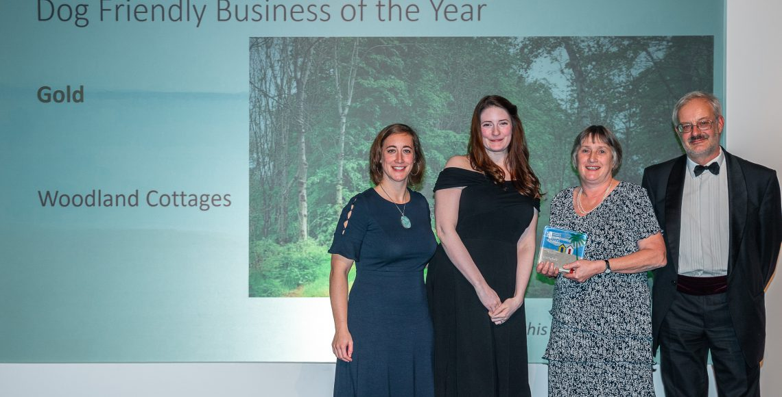 Woodland Cottages receiving the gold award for Dog friendly business of the Year in the Devon Tourism Awards